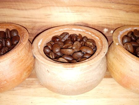 Coffee beans in small jars
