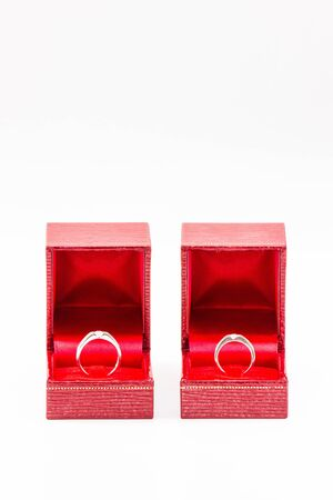 Pair diamond rings in red box with white isolate photo