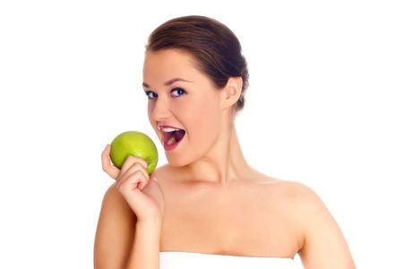 Young woman eating apple and smile over white background Stock Photo - 5016727