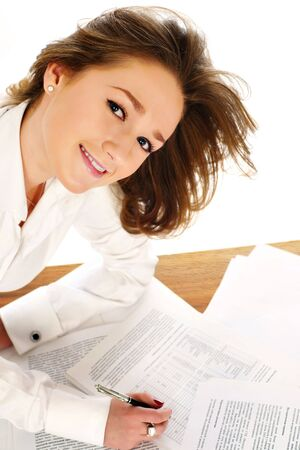Young business woman signing a document Stock Photo - 5016105