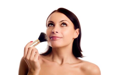 Portrait of attractive young adult woman applying blusher Stock Photo - 5011149