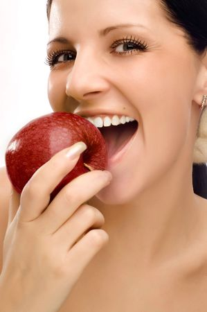 Young woman eating apple and smile over white background Stock Photo - 5011369