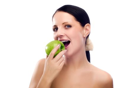 Young woman eating apple and smile over white background Stock Photo - 5011218