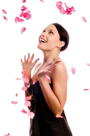 beautiful young brunette in the petals of roses Stock Photo - 5011142