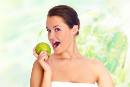 Young woman eating apple and smile over white background Stock Photo - 5016146