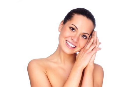 portrait of a young beautiful brunettes with perfect skin and a smile Stock Photo