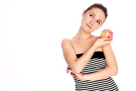 Young woman with apple over white background Stock Photo - 5025479