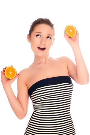 young beautiful woman with orange - isolated photo