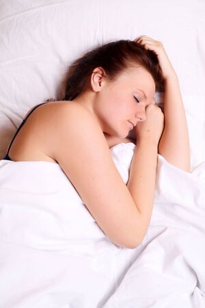beautiful young girl sleeping on white bed Stock Photo - 5622117