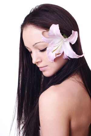 beautiful woman with eyes closed and orchids in her hair