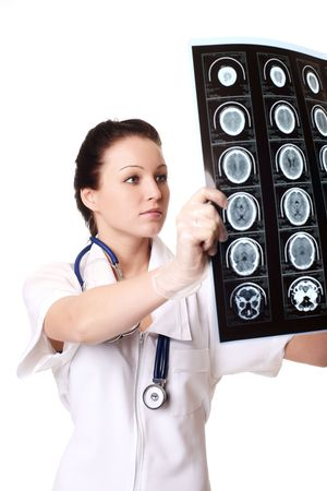 torax: woman doctor with x-rays of brain  Stock Photo