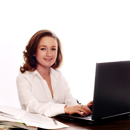 Businesswoman using a laptop and smiling photo