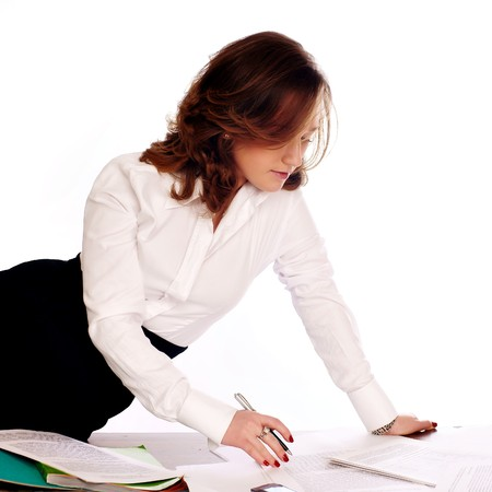 Businesswoman writing documents photo