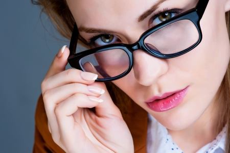 Beautiful business woman with glasses. Close-up portrait Stock Photo