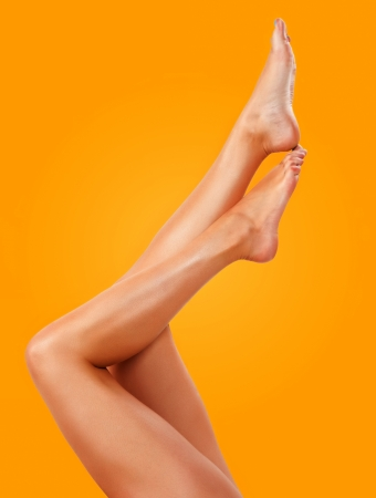 Closeup of a young woman tanned legs photo