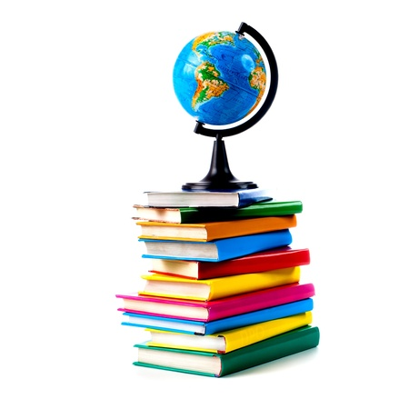 Globe on books isolated over white background photo