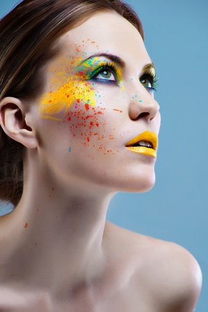 Portrait of a beautiful girl with a color make-up Stock Photo