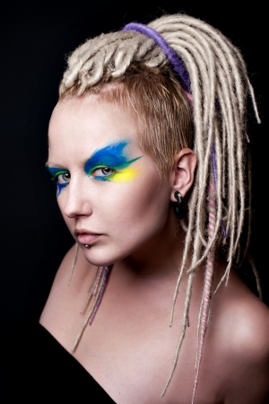 dreadlock: Portrait of young beautiful girl with fancy blue hairstyle and creative makeup