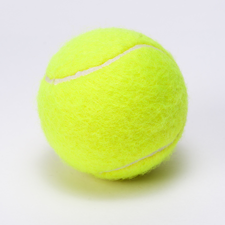 tennis ball isolated on a grey background photo