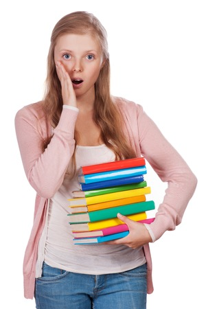 Cute young attractive student girl holding colorful exercise books. photo