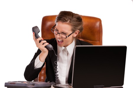 rage: Office rage series - businesswoman received bad news over the phone and is screaming in rage