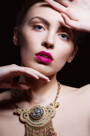 provocative woman: Sexy Beauty Girl with Pink Lips and Nails. Provocative Make up. Luxury Woman with Blue Eyes. Fashion Brunette Portrait. Gorgeous Woman Face. Stock Photo