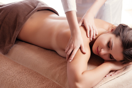 salon spa: Masseur doing massage on woman body in the spa salon. Beauty treatment concept.