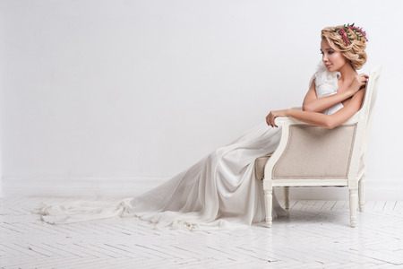 bride dress: Gorgeous bride standing on sofa