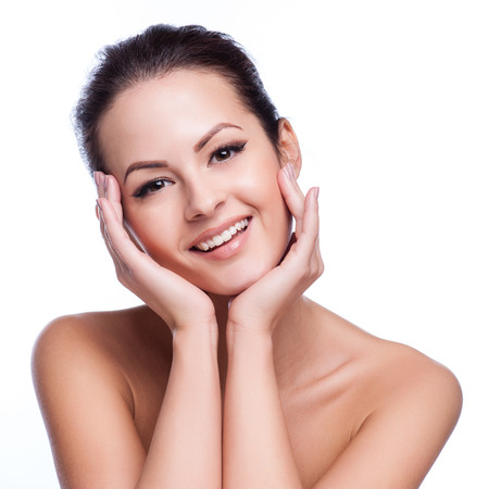 cleanse: Beautiful face of young adult woman with clean fresh skin - isolated on white