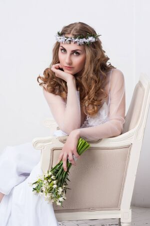 white back: Portrait of beautiful bride. Wedding dress. Wedding decoration