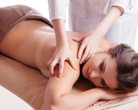 spa beauty: Masseur doing massage on woman body in the spa salon. Beauty treatment concept.