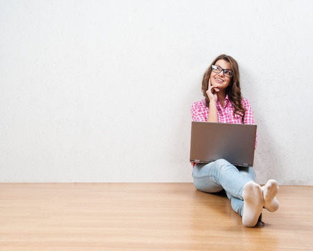 personal shopper: Young creative woman sitting in the floor with laptop. Casual  woman Stock Photo