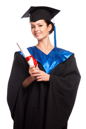 graduate: young woman college graduate portrait wearing cap and gown with diploma isolated on white background