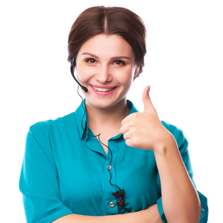 center agent: Portrait of happy smiling cheerful young support phone operator in headset showing copyspace area or something isolated over white background Stock Photo