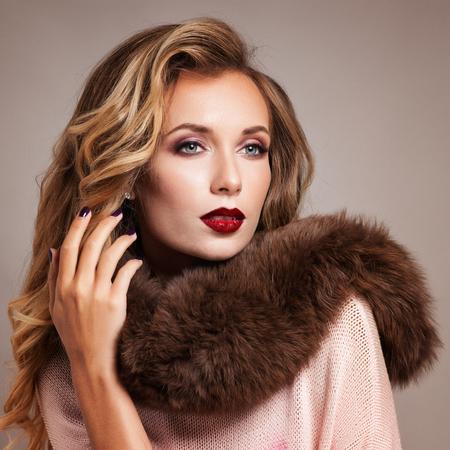 Beautiful Woman in Luxury Fur Coat Stock Photo