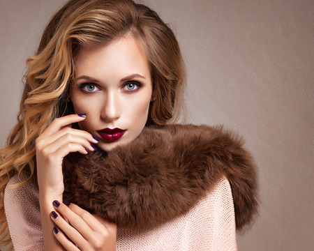 winter weather: Beautiful Woman in Luxury Fur Coat Stock Photo