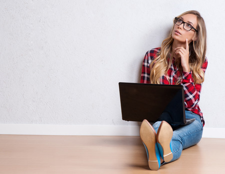 casual fashion: Young creative woman sitting in the floor with laptop. Casual blogger woman Stock Photo