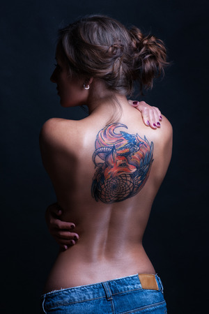 Beautiful woman with full back tattoo
