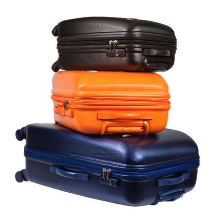 suitcase packing: Luggage consisting of three polycarbonate suitcases isolated on white Stock Photo