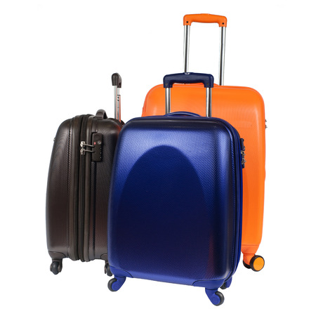 polycarbonate: Luggage consisting of three polycarbonate suitcases isolated on white Stock Photo
