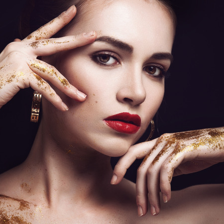 Beauty Woman with Perfect Makeup. Beautiful Professional Holiday Make-up. Purple Lips and Nails. Beauty Girl's Face isolated on Black background Standard-Bild