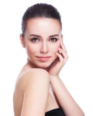 아름 다운 젊은 여자는 흰색에 그녀의 Face.Fresh 건강한 Skin.Isolated을 터치 스톡 콘텐츠 - 45080963