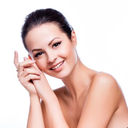 아름 다운 젊은 여자는 흰색에 그녀의 Face.Fresh 건강한 Skin.Isolated을 터치 스톡 콘텐츠 - 45105922