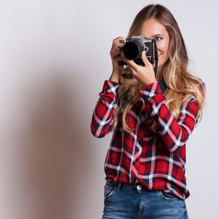 camera operator: young hipster woman with digital camera smiling Stock Photo