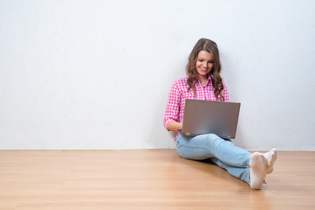 personal shopper: Young creative woman sitting in the floor with laptop. Casual blogger woman Stock Photo