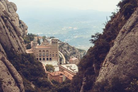 spain: Santa Maria de Montserrat Abbey in Monistrol de Montserrat, Catalonia, Spain. Famous for the Virgin of Montserrat.