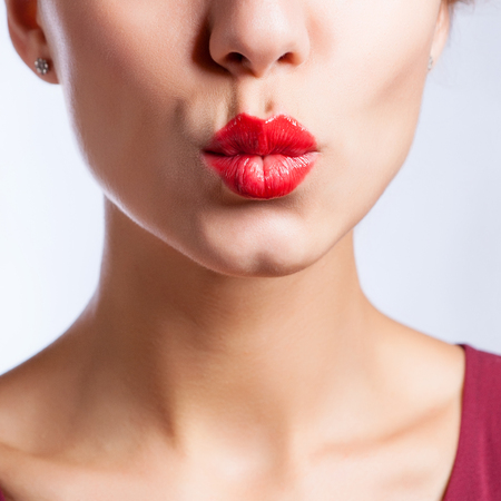 Closeup photo of a beautiful sexy red lips giving kiss