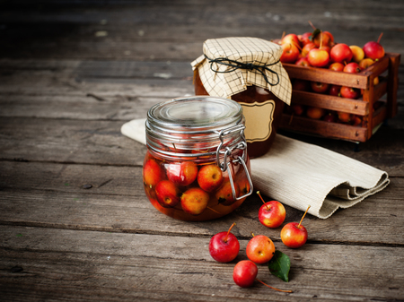 Apple jam in jar and apple fruits. Autumn still life. Selective focus