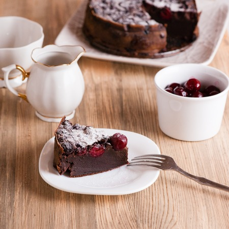cake plate: Chocolate cake with sour cherries. Close up