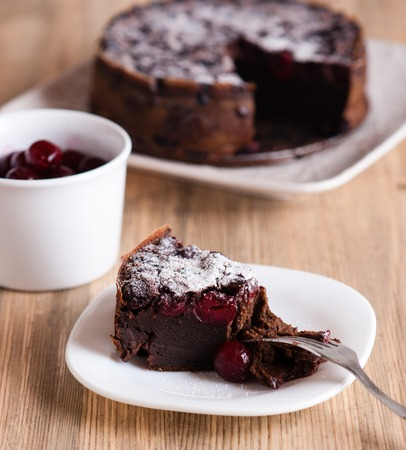 chocolate cake: Chocolate cake with sour cherries. Close up
